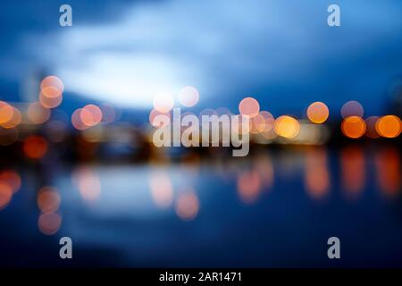abstract out of focus photograph of queens bridge and river lagan Belfast waterfront at night Northern Ireland UK possible use blurred vision eyesight - Stock Photo