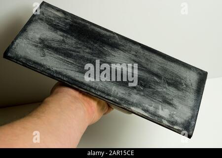 Tile layer sponge rubber board. Fliesenleger Moosgummibrett - Stock Photo
