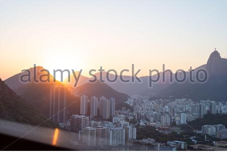 Panoramic view of Rio de Janeiro at sunset with corcovado and christ redeemer in back as viewed from Sugar Loaf mountain peak. Shot with Leica M10 - Stock Photo