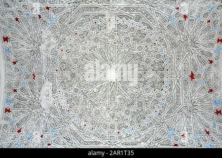18th century Islamic geometrical home ceiling designs in sculpted plaster stucco known as Naqsh-hadida, in the Bardo Museum in Tunis, Tunisia. - Stock Photo