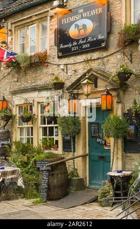 The Flemish Weaver Inn on the High Street of Corsham in Wiltshire England. The Inn is highly decorated outside with lanterns and barrels. - Stock Photo