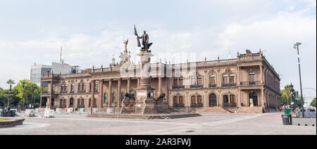 Monterrey, Nuevo Leon, Mexico - November 21, 2019:  The government palace of Nuevo leon, with the  Benito Juarez monument at the Macroplaza