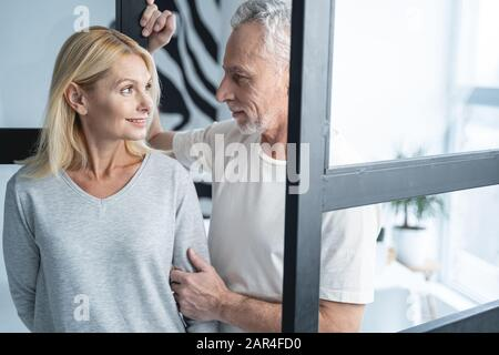 Smiling woman kindly looking at man stock photo - Stock Photo