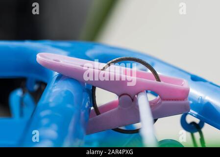 Pink plastic clothing peg hanging pin hook clip. Close up macro shot. - Stock Photo