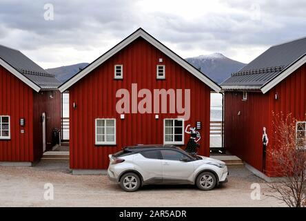 Rorbuer in Lofoten Islands, houses used by fishermen. Use for fishing has diminished and housing is now used to rent out to tourists - Accomodations - Stock Photo