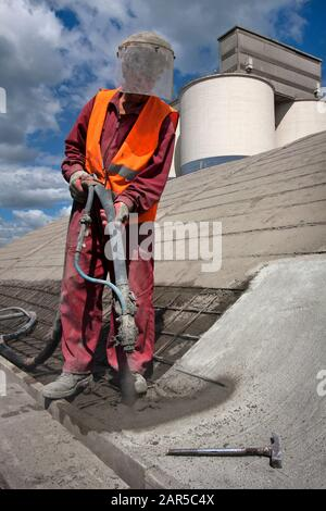 Renewing roof of industrial hale with sprayed concrete - Stock Photo