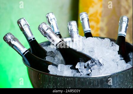 Bottles of champagne in a bucket with ice close-up - Stock Photo