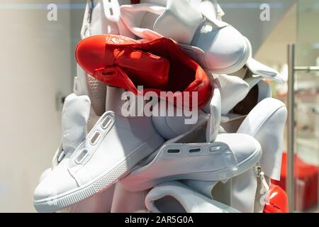 Picture of unisex sport white and red sneakers - Stock Photo