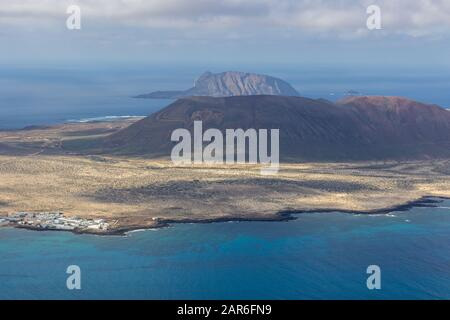 Panoramic view from viewpoint Mirador del Rio at the north of canary island Lanzarote, Spain - Stock Photo