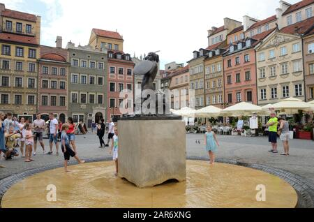 Warsaw, Poland - July 30, 2018:People around the Little Mermaid statue at the Market Square in the old town of Warsaw, Poland. - Stock Photo