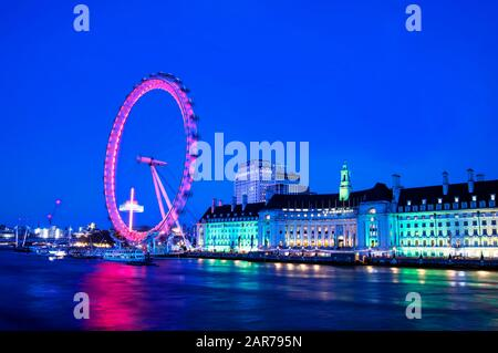 London, United Kingdom - December 14, 2019: London at twilight view on the London Eye and Thamse River Stock Photo