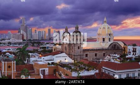 View from the walled city looking at the Church of St Peter Claver and the modern skyscrapers of Boca Grande in the background in Cartagena, Colombia - Stock Photo