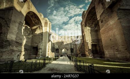 Panorama inside the Baths of Caracalla, Rome, Italy. It is a famous landmark of Rome. Amazing hdr view of the great ancient ruins of Caracalla`s Therm - Stock Photo