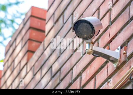 Brick wall with CCTV camera Stock Photo: 37792598 - Alamy