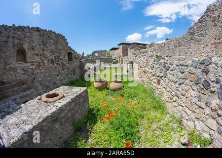 Ruins of Pompeii near Naples, Italy. Pompeii is an ancient Roman city died from the eruption of Mount Vesuvius in 1st century, tourist attraction now. - Stock Photo
