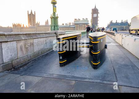Anti-terrorism barriers on the pavement at the end of Westminster Bridge, London,UK - Stock Photo