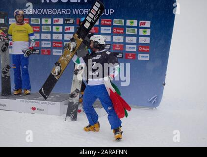 Edwin Corrati (ITA) celebrates the winning of  FIS Snowboard World cup Parallel Giant Slalom- Rogla 2020. - Stock Photo