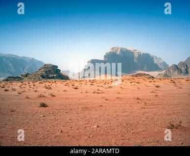 Jordan. Colourful desert mountain landscapes at the UNESCO World Heritage Site of Wadi Rum near the port of Aqaba in southern Jordan  associated with  Lawrence of Arabia. - Stock Photo