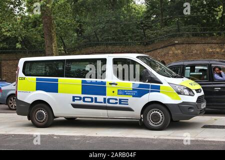 LONDON, UK - JULY 9, 2016: Ford Transit police vehicle parked in London, UK. Metropolitan Police Service has 31,000 police officers in Greater London - Stock Photo