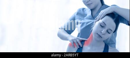 Female physiotherapist or a chiropractor adjusting patients neck. Physiotherapy, rehabilitation banner. - Stock Photo