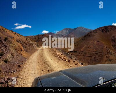 Deep valleys as seen from the Ruta 40, the road linking Cachi to San Antonio de Los Cobres, Argentina - Stock Photo