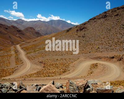 Deep valleys as seen from the Ruta 40, the road linking Cachi to San Antonio de Los Cobres, Argentina - Stock Photo