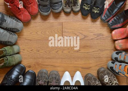 many pairs of different shoes standing in a circle as symbol for community - Stock Photo