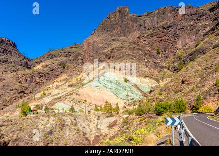 Fuente de Los Azulejos Rock Formation in Gran Canaria, Canary Islands, Spain. The colourful rocks are a side effect of hydromagmatic eruptions. - Stock Photo