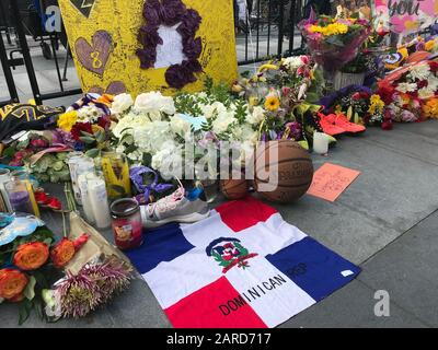 Los Angeles, California, USA. 27th Jan, 2020. General view of different objects that fans put in honor of Kobe Bryant and his daughter Gianni outside the Staples Center in Los Angeles, US, 27 January 2020. The large Latino community in Los Angeles is mourning the death of basketball star Kobe Bryant on Monday with the grief that comes with being a close relative, given the mutual love that was evident when the Lakers' player learned to speak Spanish. EFE/ Ana Milena Varon Credit: EFE News Agency/Alamy Live News - Stock Photo