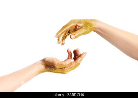 Man and woman hand in golden glitter reaching to each other isolated on white background. - Stock Photo