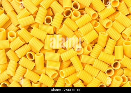 Italian Macaroni Pasta half sleeves striped raw food background or texture close up - Stock Photo