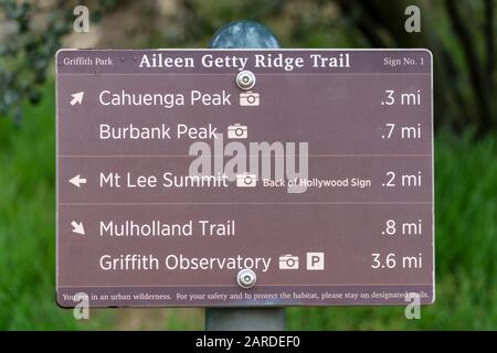 Los Angeles, California, USA - January 26, 2020:  Hiking trail sign to Griffith Observatory, Burbank Peak, Cahuenga Peak, Mt Lee and the back of the H - Stock Photo