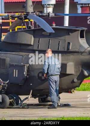 Kiowa Warrior OH-58D helicopter OH58D HRZ Croatian Air Force mechanic standing near to airframe - Stock Photo
