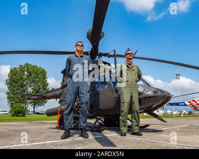 Kiowa Warrior OH-58D helicopter OH58D HRZ Croatian Air Force crew posing pose standing - Stock Photo