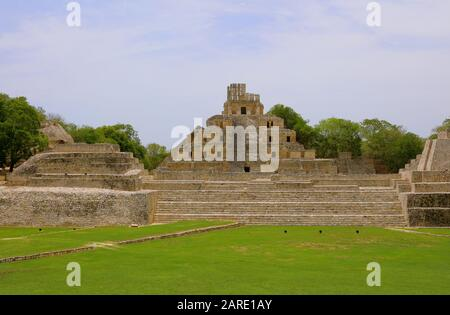 A flight of steps leads up to the Grand Acropolis quadrangle of the ancient Mayan city of Edzna, Mexico, the towering Temple of Five Storeys framed by - Stock Photo