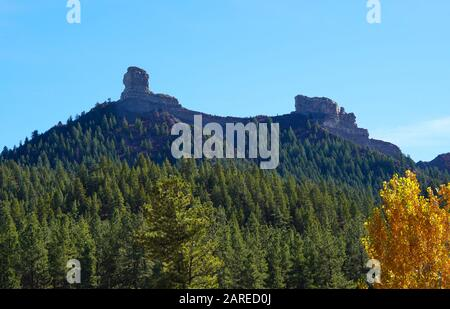 A beautiful mountain in Pagosa Springs, Colorado has a thick forest covering it's sides, and Chimney Rock on it's top. - Stock Photo