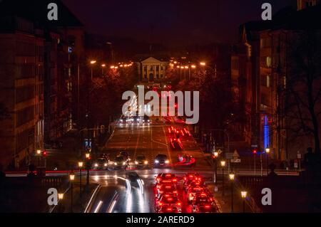 Car traffic at rush hour at the late evening in Munich, germany. - Stock Photo