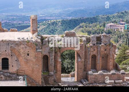 Ruins of ancient theatre in Taormina comune in Metropolitan City of Messina, on the east coast of the island of Sicily, Italy. - Stock Photo