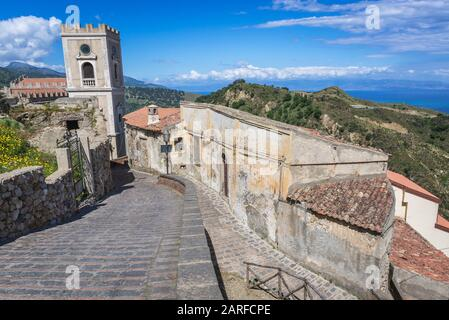 Street in Savoca village on Sicily Island in Italy - view with Church of San Nicolo also known as Church of San Lucia. - Stock Photo