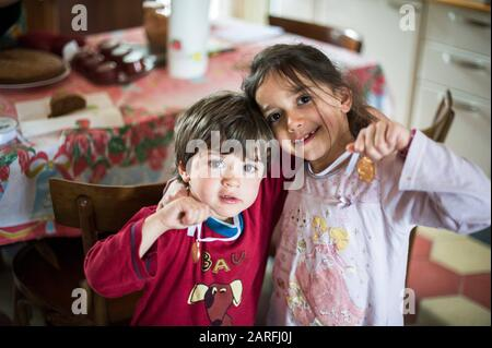 Children brothers, in the morning with pajamas and medal around his neck. - Stock Photo