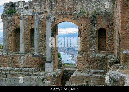 Ruins of ancient Greek theatre in Taormina (Teatro antico di Taormina). Taormina is located in the city of Messina, on the island of Sicily, Italy. - Stock Photo