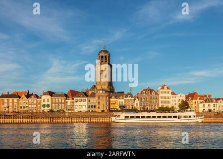 The Dutch city of Deventer in Overijssel with the river IJssel in front on a sunny day in autumn - Stock Photo