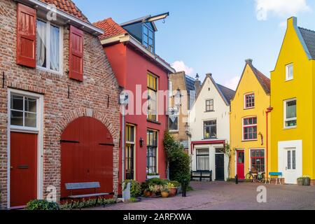 Ancient colorful houses in the famous Walstraat street in Deventer, The Netherlands - Stock Photo