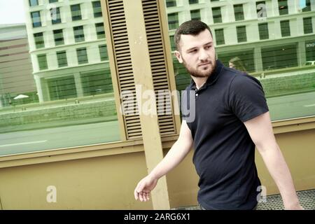 Young man walking on the street. Frankfurt am Main. Germany. - Stock Photo