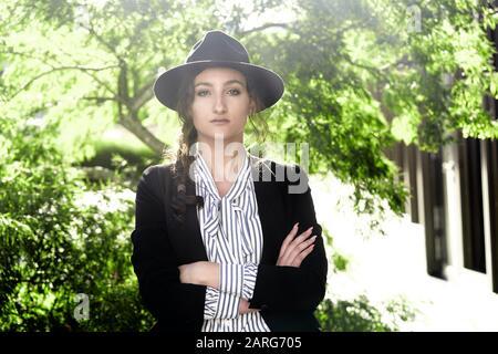 Portrait of woman wearing hat. Munich, Germany.