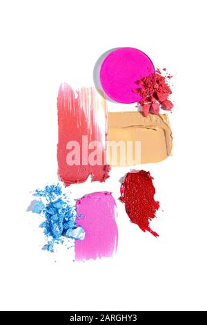 Creative concept fashion flatlay photo of cosmetics swatches beauty products lipstick eyeshadow cream foundation on white background. - Stock Photo
