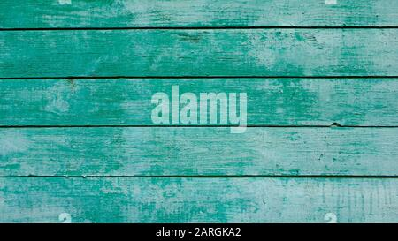 Old wood faded background painted in blue-green color - Stock Photo