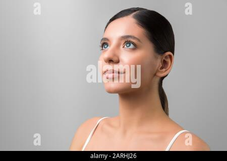 people of future. hypnotized beautiful woman with blue eyes looking up. high resolution photo - Stock Photo