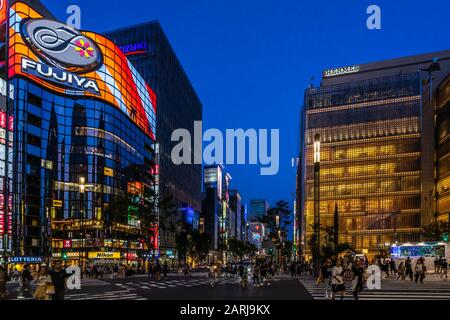 Night view of  Sukiyabashi crossing in Ginza. Ginza is considered one of the most expensive and luxury shopping districts in the world, Tokyo - Stock Photo