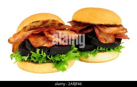 Fried bacon and black pudding sandwich rolls with lettuce isolated on a white background - Stock Photo